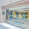 1R Apartment to Rent in Chiyoda-ku Building Entrance