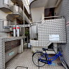 1K Apartment to Rent in Chofu-shi Building Entrance