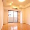 在台東區購買1K 公寓大廈的房產 臥室